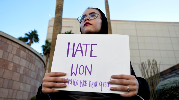 Krystina Robinson of Las Vegas carries a placard in protest against the election of Republican Donald Trump as President of the United States, across from the Trump International Hotel & Tower in Las Vegas